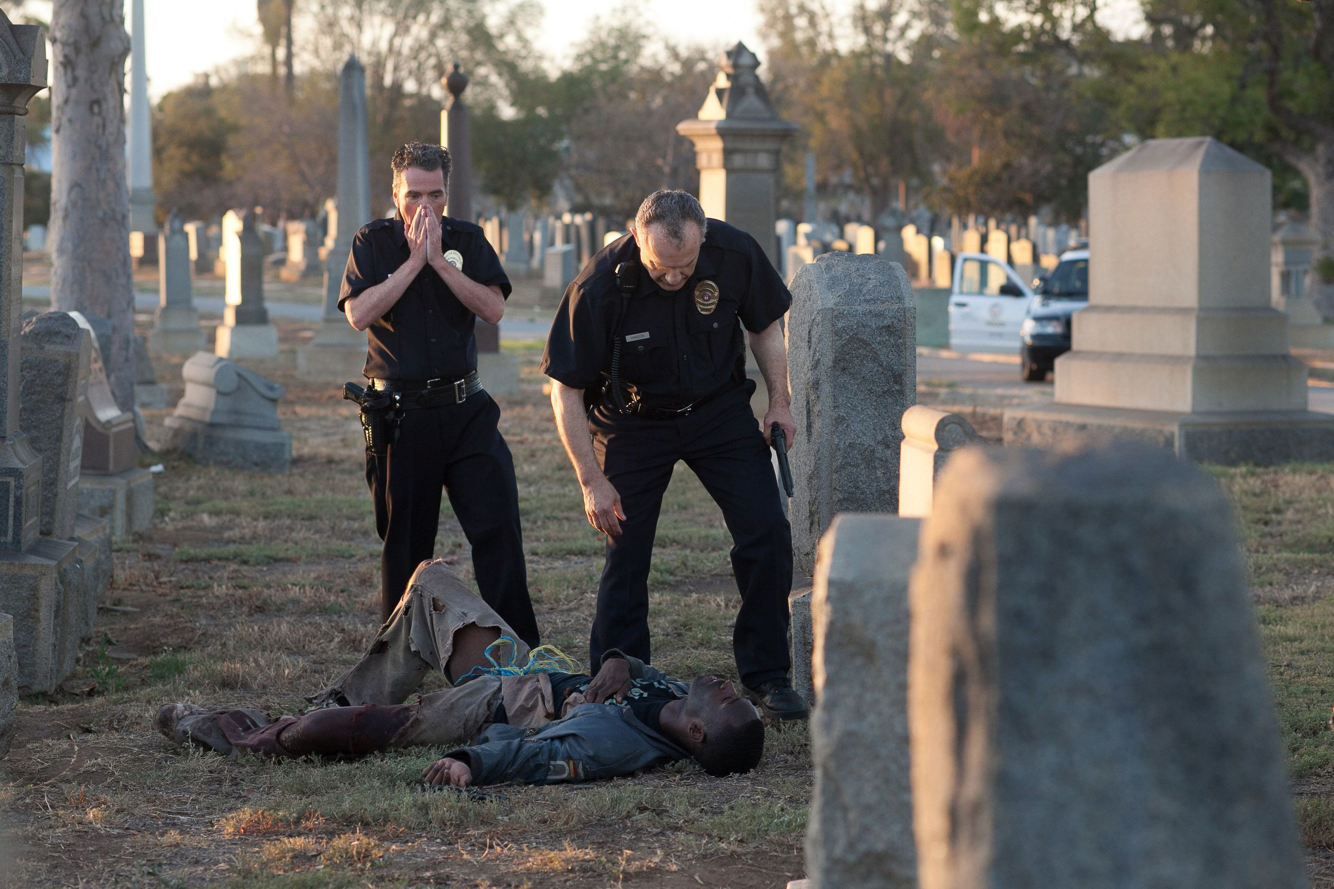 Officers (Eddie Kehler and Saun T Benjamin) shooting an unarmed black college kid Marshal (Sean Samuels) in Chad Ferrin's film Parastites. © Photo by Silvia Spross